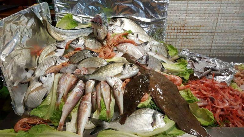 cena a base di pesce o pranzo a base di pesce