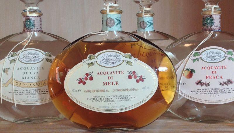 Offerta produzione distillati di frutta artigianali - Offerta acquavite di mele pesca garganega