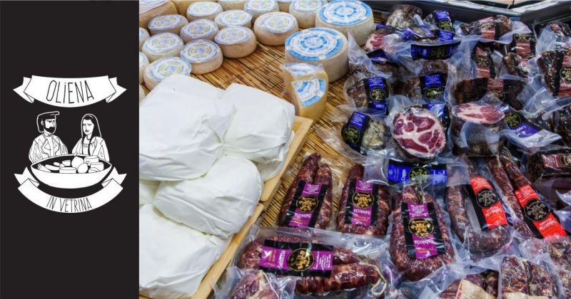 Oliena in Vetrina negozio di prodotti tipici Sardi - offerta formaggi e salumi