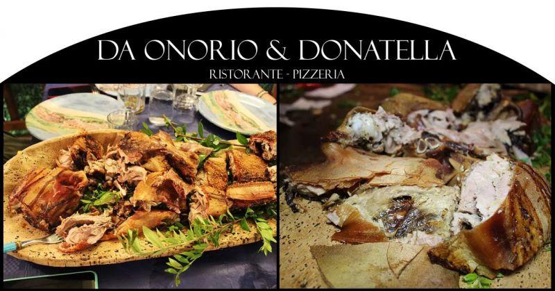 Da Onorio e Donatella - offerta ristorante che serve porcetto sardo cotto allo spiedo nel camino