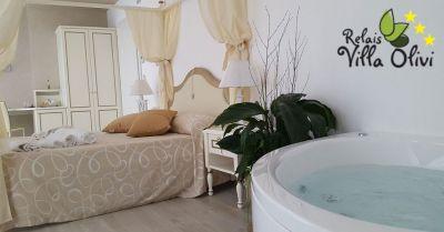 relais villa olivi bestes urlaubsangebot in einer luxussuite mit blick auf den gardasee