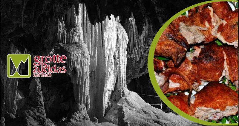Grotte is Zuddas - offerta dove mangiare maialetto sardo Santadi